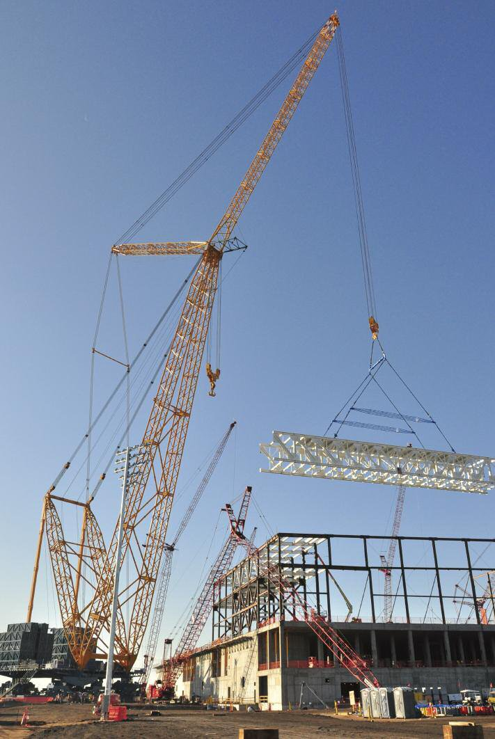 Sarens Sgc 120 At Work Lifting A Roof Truss On Site At